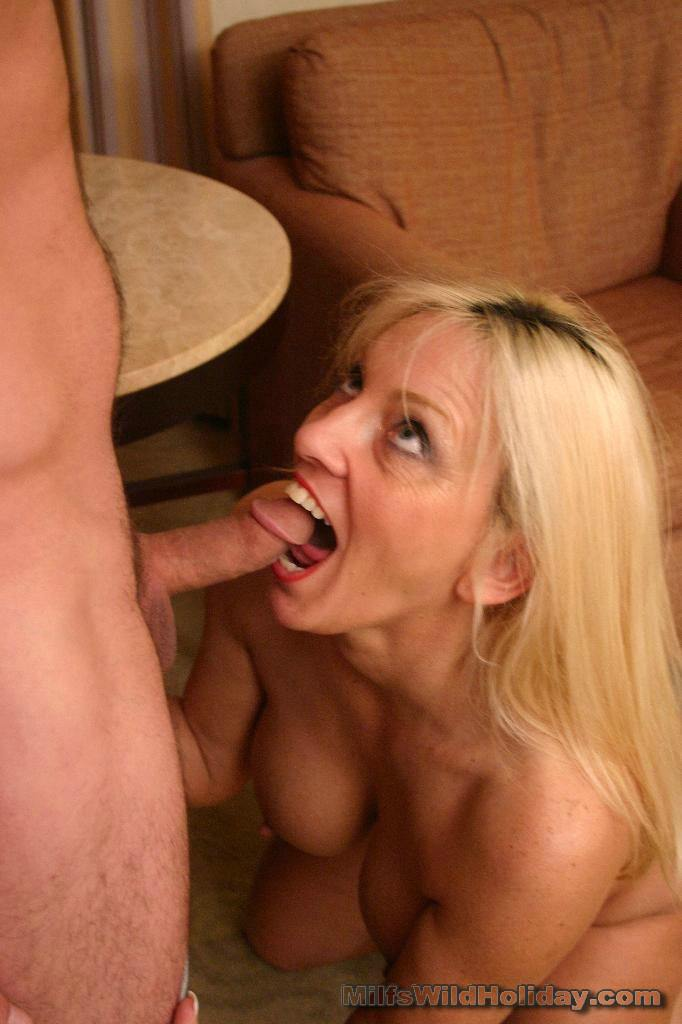 image Sexy milf gives blowjob and gets facialized